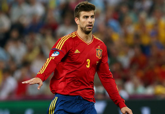 DONETSK, UKRAINE - JUNE 23:  Gerard Pique of Spain with the ball during the UEFA EURO 2012 quarter final match between Spain and France at Donbass Arena on June 23, 2012 in Donetsk, Ukraine.  (Photo by Martin Rose/Getty Images)