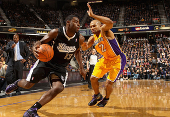 SACRAMENTO, CA - DECEMBER 26:  Tyreke Evans #13 of the Sacramento Kings drives on Derek Fisher #2 of the Los Angeles Lakers at Power Balance Pavilion on December 26, 2011 in Sacramento, California.  NOTE TO USER: User expressly acknowledges and agrees tha