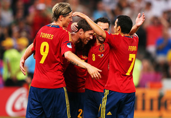 DONETSK, UKRAINE - JUNE 23:  Xabi Alonso (2nd L) of Spain celebrates after scoring the second goal with team mates during the UEFA EURO 2012 quarter final match between Spain and France at Donbass Arena on June 23, 2012 in Donetsk, Ukraine.  (Photo by Ale