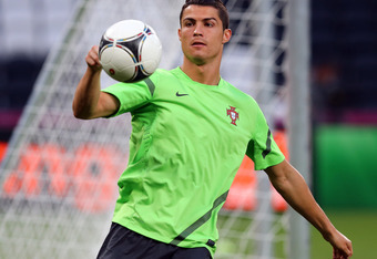 DONETSK, UKRAINE - JUNE 26:  Cristiano Ronaldo plays the ball during a Portugal training session ahead of UEFA Euro 2012 Semi-Final 2012 at Donbass Arena on June 26, 2012 in Donetsk, Ukraine.  (Photo by Martin Rose/Getty Images)