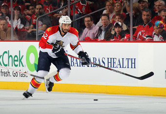 NEWARK, NJ - APRIL 17:  Jason Garrison #52 of the Florida Panthers skates with the puck in Game Three of the Eastern Conference Quarterfinals during the 2012 NHL Stanley Cup Playoffs at Prudential Center on April 17, 2012 in Newark, New Jersey. The Panthe