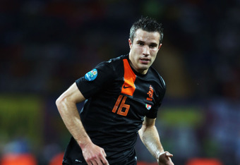 KHARKOV, UKRAINE - JUNE 17:  Robin van Persie of Netherlands runs with the ball during the UEFA EURO 2012 group B match between Portugal and Netherlands at Metalist Stadium on June 17, 2012 in Kharkov, Ukraine.  (Photo by Ian Walton/Getty Images)