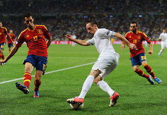 DONETSK, UKRAINE - JUNE 23: Franck Ribery of France controls the ball infront of Alvaro Arbeloa of Spain during the UEFA EURO 2012 quarter final match between Spain and France at Donbass Arena on June 23, 2012 in Donetsk, Ukraine.  (Photo by Laurence Grif