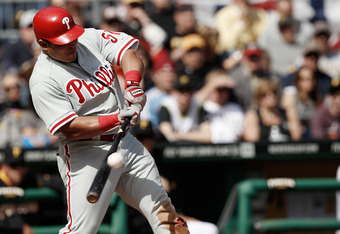 PITTSBURGH, PA - APRIL 05:  Carlos Ruiz #51 of the Philadelphia Phillies hits a sacrifice fly in the 7th inning against the Pittsburgh Pirates during the Opening Day game on April 5, 2012 at PNC Park in Pittsburgh, Pennsylvania.  (Photo by Jared Wickerham