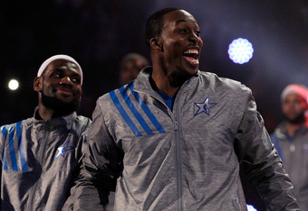 ORLANDO, FL - FEBRUARY 26:  (L-R) LeBron James #6 of the Miami Heat and the Eastern Conference and Dwight Howard #12 of the Orlando Magic and the Eastern Conference react during player introductions for the 2012 NBA All-Star Game at the Amway Center on Fe