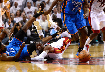 MIAMI, FL - JUNE 21:  Dwyane Wade #3 of the Miami Heat and James Harden #13 of the Oklahoma City Thunder fight for a loose ball in the first half of Game Five of the 2012 NBA Finals on June 21, 2012 at American Airlines Arena in Miami, Florida. NOTE TO US