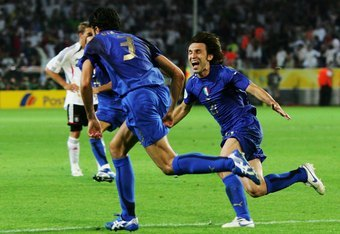 DORTMUND, GERMANY - JULY 04:  Fabio Grosso of Italy celebrates scoring his team's first goal in extra time with team mate Andrea Pirlo (R) during the FIFA World Cup Germany 2006 Semi-final match between Germany and Italy played at the Stadium Dortmund on
