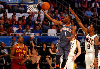 ORLANDO, FL - FEBRUARY 24:  Kemba Walker #1 of the Charlotte Bobcats and Team Shaq drives for a shot attempt against MarShon Brooks #9 of the New Jersey Nets and Team Chuck during the BBVA Rising Stars Challenge part of the 2012 NBA All-Star Weekend at Am