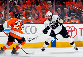 PHILADELPHIA, PA - APRIL 22:  Kris Letang #58 of the Pittsburgh Penguins shoots against the Philadelphia Flyers in Game Six of the Eastern Conference Quarterfinals during the 2012 NHL Stanley Cup Playoffs at Wells Fargo Center on April 22, 2012 in Philade