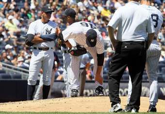 NEW YORK, NY - JUNE 27:  Andy Pettitte #46 of the New York Yankees grabs his leg as he is checked on after he was hit with a batted ball in the fifth inning against the Cleveland Indians at Yankee Stadium on June 27, 2012  in the Bronx borough of New York