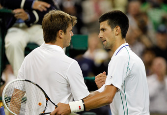 LONDON, ENGLAND - JUNE 27:  Novak Djokovic of Serbia (R) is congratulated by Ryan Harrison of USA after their Gentlemen's Singles second round match on day three of the Wimbledon Lawn Tennis Championships at the All England Lawn Tennis and Croquet Club on