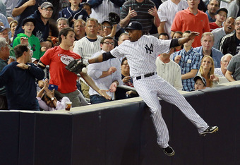 NEW YORK, NY - JUNE 26:  Dewayne Wise #45 of the New York Yankees falls into the stands after making a catch off the bat of Jack Hannahan #9 of the Cleveland Indians in the seventh-inning at Yankee Stadium on June 26, 2012 in the Bronx borough of New York
