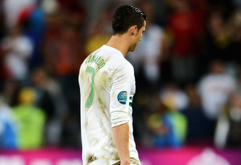 DONETSK, UKRAINE - JUNE 27:  Cristiano Ronaldo of Portugal looks dejected after losing a penalty shoot out during the UEFA EURO 2012 semi final match between Portugal and Spain at Donbass Arena on June 27, 2012 in Donetsk, Ukraine.  (Photo by Jasper Juine