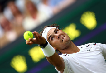 LONDON, ENGLAND - JUNE 26:  Rafael Nadal of Spain serves during his Gentlemen's Singles first round match against Thomaz Bellucci of Brazil on day two of the Wimbledon Lawn Tennis Championships at the All England Lawn Tennis and Croquet Club on June 26, 2