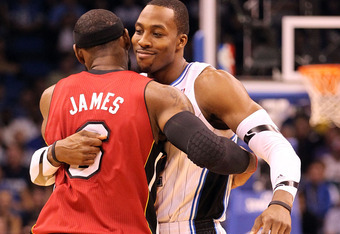 ORLANDO, FL - FEBRUARY 08:  LeBron James #6 of the Miami Heat hugs Dwight Howard #12 of the Orlando Magic during the game at Amway Center on February 8, 2012 in Orlando, Florida.   NOTE TO USER: User expressly acknowledges and agrees that, by downloading