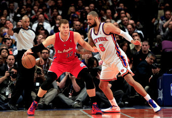 NEW YORK, NY - APRIL 25: Blake Griffin #32 of the Los Angeles Clippers controls the ball against Tyson Chandler #6 of the New York Knicks at Madison Square Garden on April 25, 2012 in New York City. NOTE TO USER: User expressly acknowledges and agrees tha