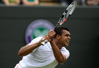 LONDON, ENGLAND - JUNE 26:  Jo-Wilfried Tsonga of France in action during his Gentlemen's Singles first round match against Lleyton Hewitt of Australia on day two of the Wimbledon Lawn Tennis Championships at the All England Lawn Tennis and Croquet Club o