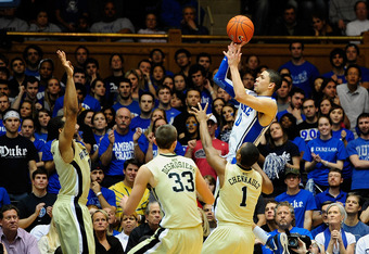 DURHAM, NC - JANUARY 19:  Austin Rivers #0 of the Duke Blue Devils pulls up for a three-point shot along the baseline against the Wake Forest Demon Deacons during play at Cameron Indoor Stadium on January 19, 2012 in Durham, North Carolina. Duke won 91-73
