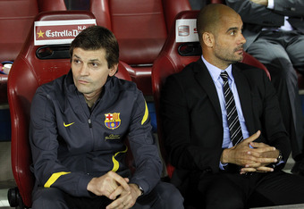 MADRID, SPAIN - MAY 25: Head coach Pep Guardiola (R) of Barcelona looks on beside his assistant Tito Vilanova during the Copa del Rey Final match between Athletic Bilbao and Barcelona at Vicente Calderon Stadium on May 25, 2012 in Madrid, Spain.  (Photo b