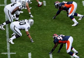 DENVER - SEPTEMBER 16:  The Raiders offensive line and the Broncos defensive line square off as the Denver Broncos defeated the Oakland Raiders 23-20 in overtime during week two NFL action at Invesco Field at Mile High on September 16, 2007 in Denver, Col