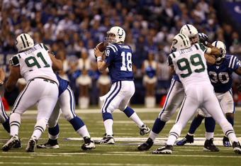 INDIANAPOLIS, IN - JANUARY 08:  Quarterback Peyton Manning #18 of the Indianapolis Colts looks to pass the ball against the New York Jets during their 2011 AFC wild card playoff game at Lucas Oil Stadium on January 8, 2011 in Indianapolis, Indiana. The Je