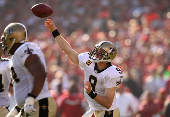 SAN FRANCISCO, CA - JANUARY 14:  Drew Brees #9 of the New Orleans Saints throws the ball against the San Francisco 49ers during the NFC Divisional playoff game at Candlestick Park on January 14, 2012 in San Francisco, California. The 49ers won the game 36