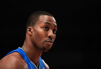 NEW YORK, NY - MARCH 28: Dwight Howard #12 of the Orlando Magic looks on against the New York Knicks at Madison Square Garden on March 28, 2012 in New York City. NOTE TO USER: User expressly acknowledges and agrees that, by downloading and/or using this P