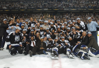 TAMPA, FL - JUNE 7:  Tampa Bay Lightning players and staff pose for a team photo with the Stanley Cup after defeating the Calgary Flames in Game seven of the NHL Stanley Cup Finals on June 7, 2004 at the St. Pete Times Forum in Tampa, Florida. The Lightni