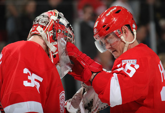 DETROIT, MI - JANUARY 23:  Jimmy Howard #35 of the Detroit Red Wings celebrates a win over the St.Louis Blues with Jiri Hudler #26 of the Detroit Red Wings during their NHL game at Joe Louis Arena on January 23, 2012 in Detroit, Michigan.  (Photo by Dave