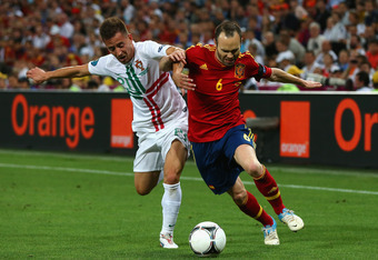 DONETSK, UKRAINE - JUNE 27: Joao Pereira (L) of Portugal competes with Andres Iniesta of Spainduring the UEFA EURO 2012 semi final match between Portugal and Spain at Donbass Arena on June 27, 2012 in Donetsk, Ukraine.  (Photo by Martin Rose/Getty Images)