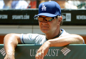 SAN FRANCISCO, CA - JUNE 27:  Manager Don Mattingly #8 of the Los Angeles Dodgers looks on from the dugout in the second inning against the San Francisco Giants at AT&T Park on June 27, 2012 in San Francisco, California.  (Photo by Thearon W. Henderson/Ge