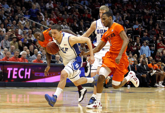 ATLANTA, GA - MARCH 09:  Austin Rivers #0 of the Duke Blue Devils pushes the ball up court against Robert Brown #1 of the Virginia Tech Hokies in their Quarterfinal game of the 2012 ACC Men's Basketball Conferene Tournament at Philips Arena on March 9, 20