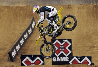 LOS ANGELES, CA - JULY 28:  Travis Pastrana attempts his jump in the Moto X Best Trick Final during day 1 of the X Games 17 at the Staples Centrer on July 28, 2011 in Los Angeles, California. Pastrana could not land his jump and left with an injury.  (Pho