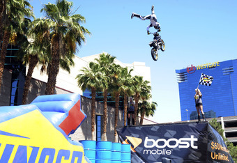 LAS VEGAS, NV - JUNE 04:  Travis Pastrana performs a motorcycle stunt during the Nitro Circus on June 4, 2011 in Las Vegas, Nevada.  (Photo by Bryan Haraway/Getty Images for Michael Waltrip Racing)