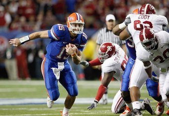 ATLANTA - DECEMBER 06:  Quarterback Tim Tebow #15 of the Florida Gators runs the ball against the Alabama Crimson Tide during the SEC Championship on December 6, 2008 at the Georgia Dome in Atlanta, Georgia.  (Photo by Kevin C. Cox/Getty Images)
