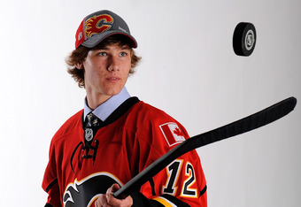 PITTSBURGH, PA - JUNE 22:  Mark Jankowski, 21st overall pick by the Calgary Flames, poses for a portrait during the 2012 NHL Entry Draft at Consol Energy Center on June 22, 2012 in Pittsburgh, Pennsylvania.  (Photo by Jamie Sabau/Getty Images)