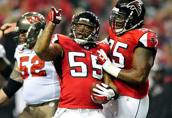 ATLANTA, GA - JANUARY 01:  John Abraham #55 and Jonathan Babineaux #95 of the Atlanta Falcons celebrate after Abraham's sack and fumble recovery against the Tampa Bay Buccaneers during play at the Georgia Dome on January 1, 2012 in Atlanta, Georgia.  (Pho