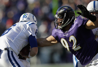 BALTIMORE, MD - DECEMBER 11:  Haloti Ngata #92 of the Baltimore Ravens sacks Dan Orlovsky #6 of the Indianapolis Colts during the first half at M&T Bank Stadium on December 11, 2011 in Baltimore, Maryland.  (Photo by Rob Carr/Getty Images)