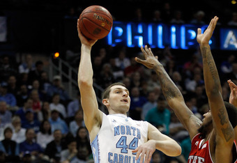 ATLANTA, GA - MARCH 10:  Tyler Zeller #44 of the North Carolina Tar Heels attempts a shot against Richard Howell #1 of the North Carolina State Wolfpack during their Semifinal game of the 2012 ACC Men's Basketball Conferene Tournament at Philips Arena on