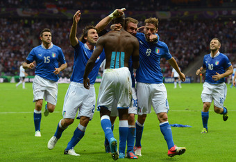 Mario Balotelli celebrates with his teammates after scoring his second goal against Germany.