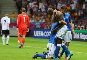 Balotelli celebrates after scoring a brace