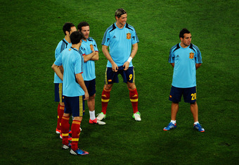DONETSK, UKRAINE - JUNE 27:   Juan Mata  (3rd L), Fernando Torres (C) and Santi Cazorla (R) of Spain look on ahead of the UEFA EURO 2012 semi final match between Portugal and Spain at Donbass Arena on June 27, 2012 in Donetsk, Ukraine.  (Photo by Lars Bar
