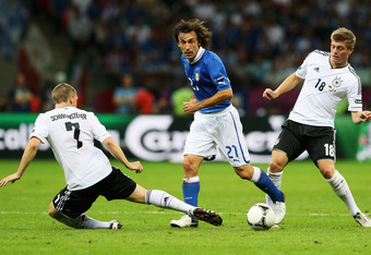 WARSAW, POLAND - JUNE 28:  Andrea Pirlo (C) of Italy evades a challenge from Bastian Schweinsteiger (L) and Toni Kroos of Germany during the UEFA EURO 2012 semi final match between Germany and Italy at the National Stadium on June 28, 2012 in Warsaw, Pola