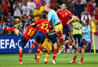 DONETSK, UKRAINE - JUNE 27:  Spain players celebrate victory  during the UEFA EURO 2012 semi final match between Portugal and Spain at Donbass Arena on June 27, 2012 in Donetsk, Ukraine.  (Photo by Alex Livesey/Getty Images)