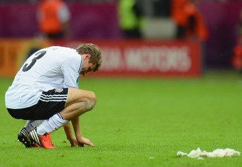 WARSAW, POLAND - JUNE 28:  Thomas Muller of Germany shows his dejection during the UEFA EURO 2012 semi final match between Germany and Italy at the National Stadium on June 28, 2012 in Warsaw, Poland.  (Photo by Shaun Botterill/Getty Images)
