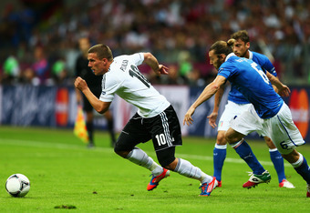 WARSAW, POLAND - JUNE 28:  Lukas Podolski (L) of Germany and Federico Balzaretti of Italy during the UEFA EURO 2012 semi final match between Germany and Italy at the National Stadium on June 28, 2012 in Warsaw, Poland.  (Photo by Michael Steele/Getty Imag