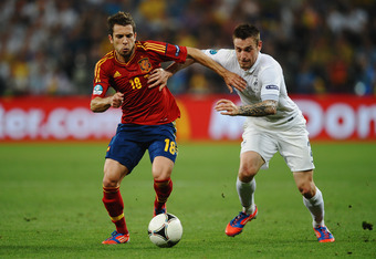 DONETSK, UKRAINE - JUNE 23:  Jordi Alba of Spain and Mathieu Debuchy of France challenge for the ball during the UEFA EURO 2012 quarter final match between Spain and France at Donbass Arena on June 23, 2012 in Donetsk, Ukraine.  (Photo by Laurence Griffit