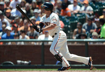 SAN FRANCISCO, CA - JUNE 27:  Ryan Theriot #5 of the San Francisco Giants hits a single in the third inning against the Los Angeles Dodgers at AT&T Park on June 27, 2012 in San Francisco, California.  (Photo by Thearon W. Henderson/Getty Images)