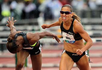 EUGENE, OR - JUNE 23:  (L-R) Michelle Perry and Lolo Jones compete in the women's 100 meter hurdles semi-final during Day Two of the 2012 U.S. Olympic Track & Field Team Trials at Hayward Field on June 23, 2012 in Eugene, Oregon.  (Photo by Michael Heiman