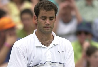 2 Jul 2001:  A dejected Pete Sampras of the USA after lossing to Roger Federer of Switzerland during the men's fourth round of The All England Lawn Tennis Championship at Wimbledon, London.  DIGITAL IMAGE Mandatory Credit: Clive Brunskill/ALLSPORT